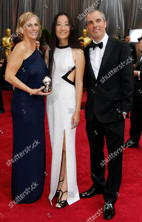 Melissa Cobb, Yuh Nelson, Raymond Zibac Producer Melissa Cobb, left, director Jennifer Yuh Nelson, center, and production designer Raymond Zibach arrive before the 84th Academy Awards, in the Hollywood section of Los Angeles