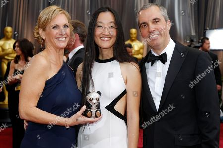Stock Image of Jennifer Yuh Nelson, Melissa Cobb, Raymond Zibach Producer Melissa Cobb, left, director Jennifer Yuh Nelson, center, and production designer Raymond Zibach arrive before the 84th Academy Awards, in the Hollywood section of Los Angeles