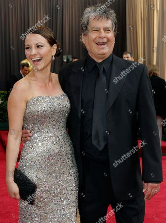 Robert Gould Robert Gould, right, and guest arrives before the 84th Academy Awards, in the Hollywood section of Los Angeles