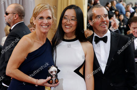 Melissa Cobb, Jennifer Yuh Nelson, Raymond Zibach Producer Melissa Cobb, left, director Jennifer Yuh Nelson, center, and production designer Raymond Zibach arrive before the 84th Academy Awards, in the Hollywood section of Los Angeles