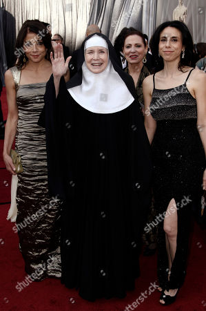 Stock Picture of Julie Anderson, Delores Hart, Rebecca Cammisa From left, Julie Anderson, Delores Hart and Rebecca Cammisa arrive before the 84th Academy Awards, in the Hollywood section of Los Angeles