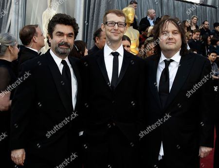 Stock Image of Joe Berlinger, Jason Baldwin, Bruce Sinofsky From left, Joe Berlinger, Jason Baldwin and Bruce Sinofsky arrive before the 84th Academy Awards, in the Hollywood section of Los Angeles
