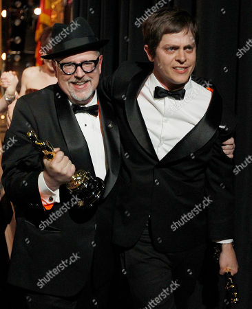 """William Joyce, Brandon Oldenburg William Joyce, left, and Brandon Oldenburg leave the stage after winning best animated short film for """"The Fantastic Flying Books of Mr. Morris Lessmore""""at the 84th Academy Awards, in the Hollywood section of Los Angeles"""