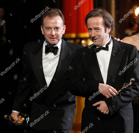 "Philip Stockton, Eugene Gearty Philip Stockton, right, and Eugene Gearty walk offstage after receiving the Oscar for best sound editing for ""Hugo"" at the 84th Academy Awards, in the Hollywood section of Los Angeles"