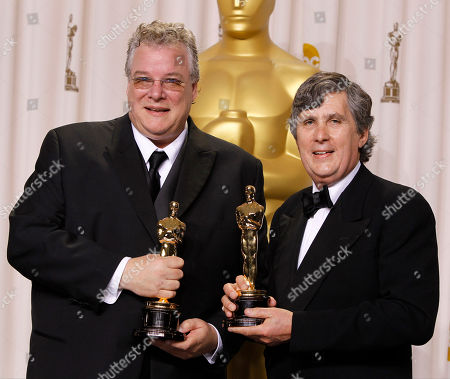 """Tom Fleischman, John Midgley Tom Fleischman, left, and John Midgley pose with their awards for best achievement in sound mixing for """"Hugo"""" during the 84th Academy Awards, in the Hollywood section of Los Angeles"""