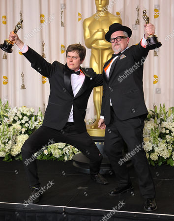"""Brandon Oldenburg, left, and William Joyce pose with their Oscars for best animated short film for their work in """"The Fantastic Flying Books of Mr. Morris Lessmore"""" during the 84th Academy Awards, in the Hollywood section of Los Angeles"""