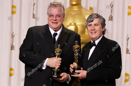 """Stock Photo of Tom Fleischman, left, and John Midgley pose with their Oscars for achievement in sound mixing for their work in """"Hugo"""" during the 84th Academy Awards, in the Hollywood section of Los Angeles"""