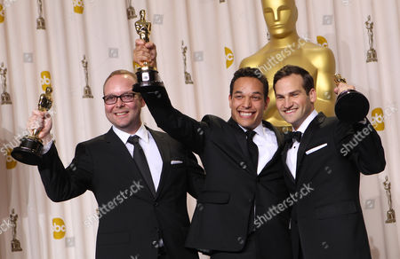"Rich Middlemas, TJ Martin, Daniel Lindsay Rich Middlemas, TJ Martin and Daniel Lindsay pose with their Oscars for best documentary feature for their work in ""Undefeated"" during the 84th Academy Awards, in the Hollywood section of Los Angeles"
