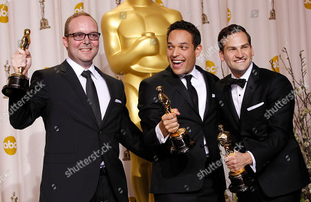 "Rich Middlemas, TJ Martin, Daniel Lindsay Rich Middlemas, left, TJ Martin, center, and Daniel Lindsay pose with their awards for best documentary feature for ""Undefeated"" during the 84th Academy Awards, in the Hollywood section of Los Angeles"