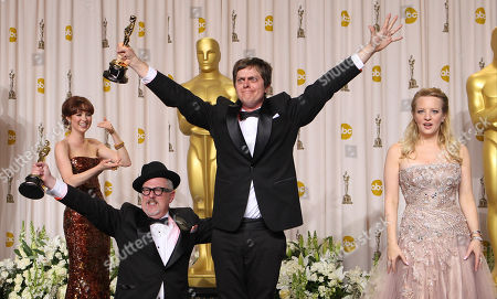"""Brandon Oldenburg, William Joyce, Ellie Kemper, Wendi McLendon-Covey Brandon Oldenburg, second from left, and William Joyce, second from right, pose with presenters Ellie Kemper, left, and Wendi McLendon-Covey as they jump with their awards for best animated short film for """"The Fantastic Flying Books of Mr. Morris Lessmore"""" during the 84th Academy Awards, in the Hollywood section of Los Angeles"""