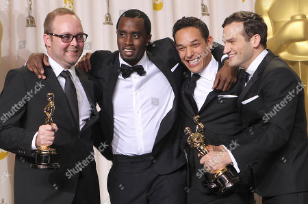 "Stock Image of Rich Middlemas, TJ Martin, Daniel Lindsay, Sean Combs Rich Middlemas, left, TJ Martin, second from right, and Daniel Lindsay, right, pose with presenter Sean ""Diddy"" Combs and their awards for best documentary feature for ""Undefeated"" during the 84th Academy Awards, in the Hollywood section of Los Angeles"