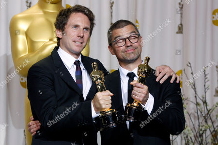 Kirk Baxter, left, and Angus Wall pose with their Oscars for achievement in film editing during the 84th Academy Awards, in the Hollywood section of Los Angeles