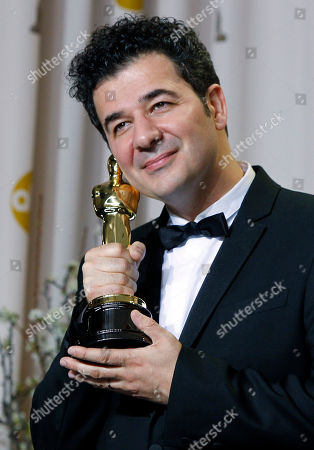 """Ludovic Bource poses with his Oscar for best original score for his work in """"The Artist"""" during the 84th Academy Awards, in the Hollywood section of Los Angeles"""