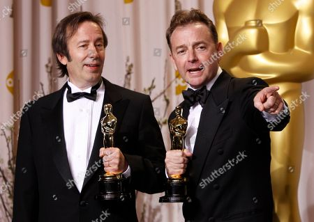 "Stock Photo of Philip Stockton, left, and Eugene Gearty pose with their Oscars for achievement in sound editing for their work in ""Hugo,"" during the 84th Academy Awards, in the Hollywood section of Los Angeles"