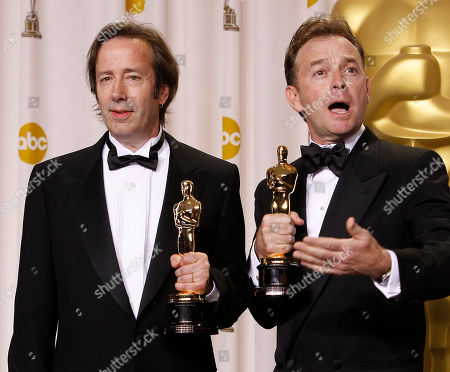"Stock Image of Philip Stockton, Eugene Gearty Philip Stockton, left, and Eugene Gearty pose with their awards for best achievement in sound editing for "" Hugo"" during the 84th Academy Awards, in the Hollywood section of Los Angeles"