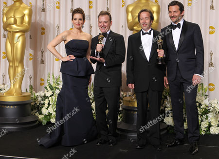 "Philip Stockton, second from left, and Eugene Gearty, second from right, pose with their Oscars for achievement in sound editing for their work in ""Hugo,"" as they stand with Tina Fey and Bradley Cooper during the 84th Academy Awards, in the Hollywood section of Los Angeles"