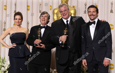 """Tom Fleischman, second from left, and John Midgley pose with their Oscars for achievement in sound mixing for their work in """"Hugo,"""" as they stand with Tina Fey and Bradley Cooper during the 84th Academy Awards, in the Hollywood section of Los Angeles"""