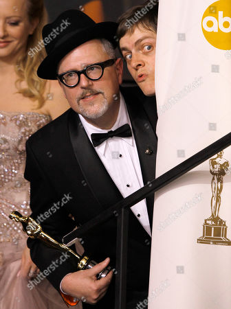 """Brandon Oldenburg, William Joyce Brandon Oldenburg, left, and William Joyce, joke with their awards for best animated short film for """"The Fantastic Flying Books of Mr. Morris Lessmore"""" during the 84th Academy Awards, in the Hollywood section of Los Angeles"""