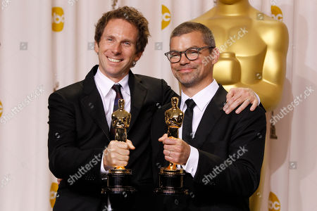 """Kirk Baxter, Angus Wall Kirk Baxter, left, and Angus Wall, pose with their awards for best achievement in film editing for """"The Girl with the Dragon Tatoo"""" during the 84th Academy Awards, in the Hollywood section of Los Angeles"""