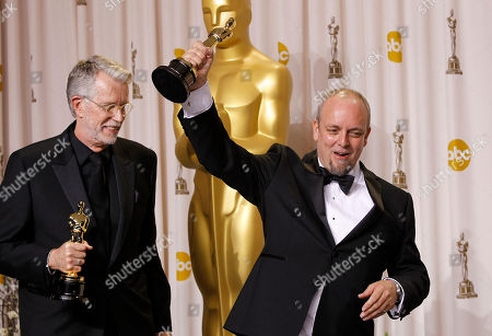 """Mark Coulier, J. Roy Helland Mark Coulier, right, and J. Roy Helland pose with their award for best achievement in makeup for """"The Iron Lady"""" during the 84th Academy Awards, in the Hollywood section of Los Angeles"""