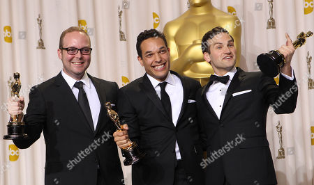 "Stock Picture of Rich Middlemas, TJ Martin, Daniel Lindsay Rich Middlemas, left, TJ Martin, center, and Daniel Lindsay pose with their awards for best documentary feature for ""Undefeated"" during the 84th Academy Awards, in the Hollywood section of Los Angeles"
