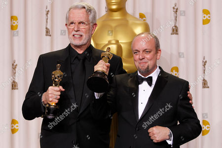 """J. Roy Helland, left, and Mark Coulier pose with their Oscars for best makeup for """"The Iron Lady"""" during the 84th Academy Awards, in the Hollywood section of Los Angeles"""