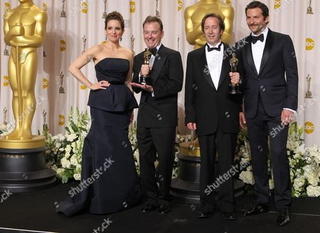 "Stock Picture of Philip Stockton, second from left, and Eugene Gearty, second from right, pose with their Oscars for achievement in sound editing for their work in ""Hugo,"" as they stand with Tina Fey and Bradley Cooper during the 84th Academy Awards, in the Hollywood section of Los Angeles"