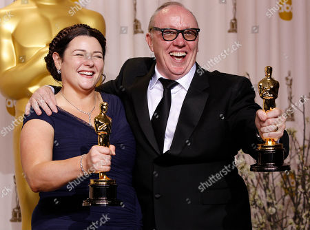 """Oorlagh George, Terry George Oorlagh George, left, and Terry George pose with their awards for best live action short film for """"The Shore"""" during the 84th Academy Awards, in the Hollywood section of Los Angeles"""