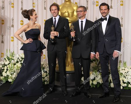 Kirk Baxter, second from left, and Angus Wall, second from right, pose with their Oscars for achievement in film editing, as they stand with Tina Fey and Bradley Cooper during the 84th Academy Awards, in the Hollywood section of Los Angeles