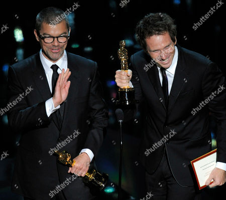 "Kirk Baxter and Angus Wall accept the Oscar for best film editing for ""The Girl with the Dragon Tattoo"" during the 84th Academy Awards, in the Hollywood section of Los Angeles"