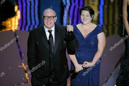 """Terry George, Oorlagh George Terry George and Oorlagh George accept the Oscar for best live action short film for """"The Shore"""" during the 84th Academy Awards, in the Hollywood section of Los Angeles"""
