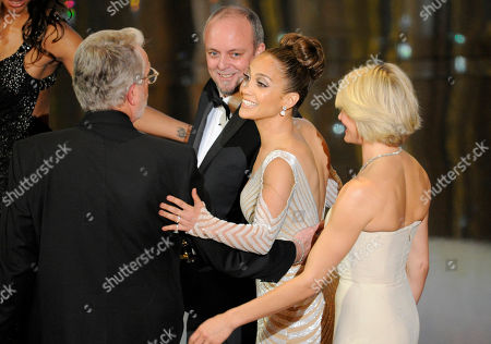 """Mark Coulier, J. Roy Helland, Jennifer Lopez, Cameron Diaz From left, winners of the Oscar for best make up for """"The Iron Lady"""" J. Roy Helland, left, and Mark Coulier, and presenters Jennifer Lopez and Cameron Diaz walk offstage during the 84th Academy Awards, in the Hollywood section of Los Angeles"""