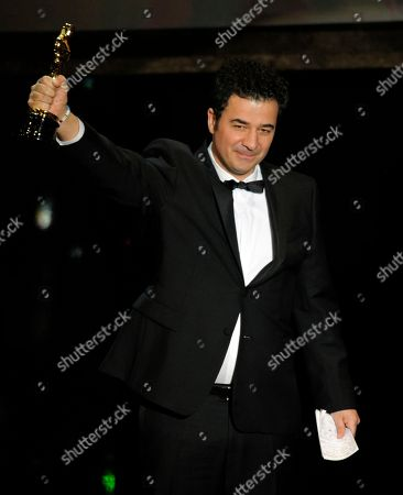 """Ludovic Bource accepts the Oscar for best original score for """"The Artist"""" during the 84th Academy Awards, in the Hollywood section of Los Angeles"""