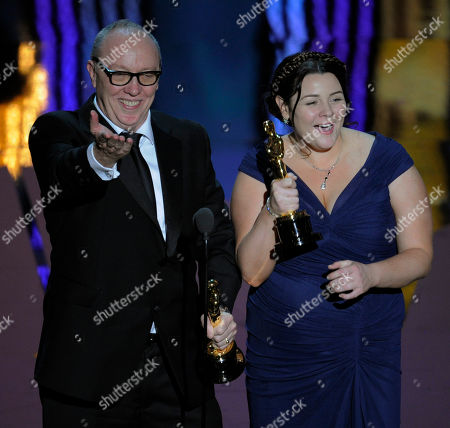 """Terry George and Oorlagh George accept the Oscar for best live action short film for """"The Shore"""" during the 84th Academy Awards, in the Hollywood section of Los Angeles"""