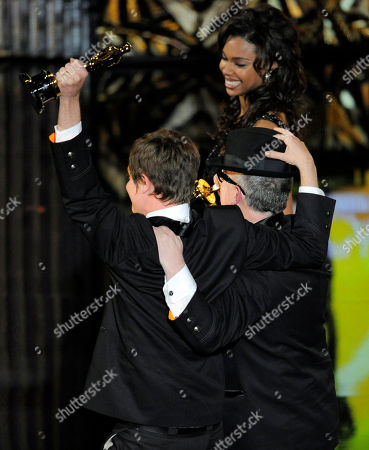 """William Joyce and Brandon Oldenburg accept the Oscar for best-animated short film for """"The Fantastic Flying Books of Mr. Morris Lessmore"""" during the 84th Academy Awards, in the Hollywood section of Los Angeles"""