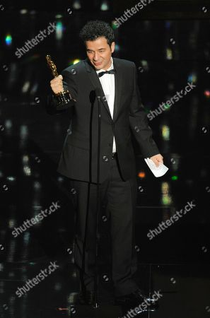 """Ludovic Bource Ludovic Bource accepts the Oscar for best original score for """"The Artist"""" during the 84th Academy Awards, in the Hollywood section of Los Angeles"""