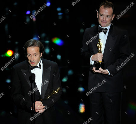 Philip Stockton and Eugene Gearty accept the Oscar for best sound editing during the 84th Academy Awards, in the Hollywood section of Los Angeles