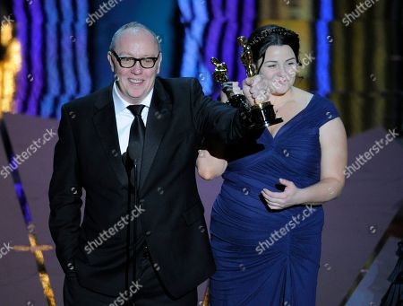 """Oorlagh George Terry George and Oorlagh George accept the Oscar for best live action short film for """"The Shore"""" during the 84th Academy Awards, in the Hollywood section of Los Angeles"""