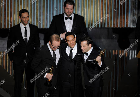 Stock Photo of TJ Martin, Dan Lindsay, Rich, Middlemas From left, TJ Martin, Dan Lindsay and Rich Middlemas accept the Oscar for best documentary feature for ???Undefeated??? during the 84th Academy Awards, in the Hollywood section of Los Angeles