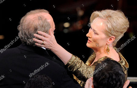 """Meryl Streep, Don Gummer Meryl Streep, right, and Don Gummer share a moment in the audience after Streep wins the oscar for best actress in a leading role for """"The Iron Lady"""" during the 84th Academy Awards, in the Hollywood section of Los Angeles"""
