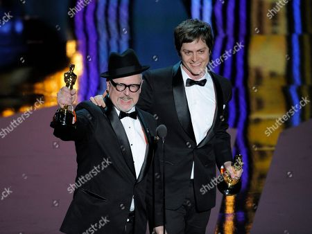"""William Joyce, Brandon Oldenburg William Joyce and Brandon Oldenburg accept the award for best animated short film for their work in """"The Fantastic Flying Books of Mr. Morris Lessmore"""" during the 84th Academy Awards, in the Hollywood section of Los Angeles"""