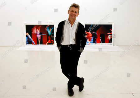 """Stock Image of Mikhail Baryshnikov Dancer Mikhail Baryshnikov, poses with two of the photographs he will be exhibiting at the Gary Nader Art Centre in Miami. The show, which opens Friday, Feb. 24, is titled """"Dance This Way"""" and features large-scale photographs of ethnic, hip-hop, ballet, modern and popular dances performed on stage by professionals and in nightclubs by amateurs"""
