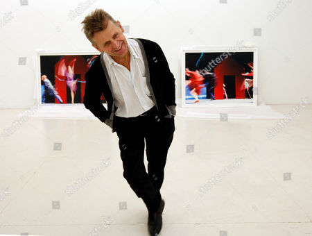 """Stock Picture of Mikhail Baryshnikov Dancer Mikhail Baryshnikov, jokes around as he poses with two of the photographs he will be exhibiting at the Gary Nader Art Centre in Miami. The show, which opens Friday, Feb. 24, is titled """"Dance This Way"""" and features large-scale photographs of ethnic, hip-hop, ballet, modern and popular dances performed on stage by professionals and in nightclubs by amateurs"""