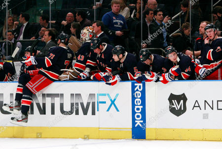 New York Rangers' Ryan McDonagh (27) and Steve Eminger (44) react with teammates in the final seconds of an NHL hockey game against the Chicago Blackhawks, in New York. The New York Rangers lost the game 4-2
