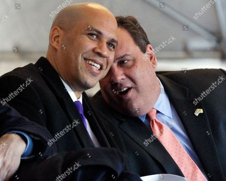 Chris Christie, Cory A. Booker New Jersey Gov. Chris Christie, right, talks with Newark Mayor Cory A. Booker during groundbreaking ceremonies for the Teachers Village development in downtown Newark, N.J. A New Jersey Democratic county chairman says Booker has told him he's considering running for governor against Chris Christie in 2013, according to The Associated Press