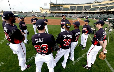 David Justice Members of the Atlanta Braves outfield staff listen to former Braves player David Justice, center, during a talk on the field at spring training baseball, in Lake Buena Vista, Fla