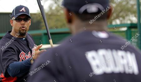 David Justice, Michael Bourn Former Atlanta Braves outfielder David Justice, left, talks to current outfielder Michael Bourn during spring training baseball, in Lake Buena Vista, Fla