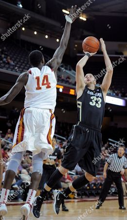 Austin Dufault, Dewayne Dedmon Colorado forward Austin Dufault, right, puts up a shot as Southern California forward Dewayne Dedmon defends during the first half of an NCAA college basketball game, in Los Angeles