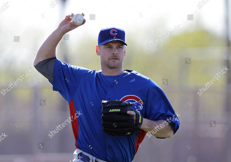 Chicago Cubs relief pitcher Kerry Wood throws a ball during a spring training baseball workout, in Mesa, Ariz
