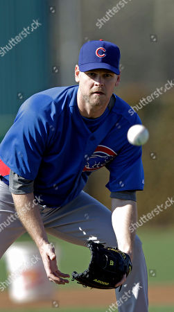 Chicago Cubs' Kerry Wood fields a ground ball during a spring training baseball workout, in Mesa, Ariz